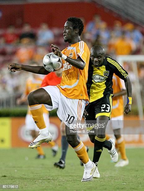Kei Kamara of the Houston Dynamo plays the ball against Ezra Hendrickson of Columbus Crew during the MLS game on August 02, 2008 at Robertson Stadium...