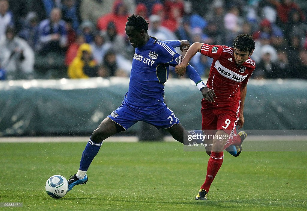 Kei Kamara #23 of the Kansas City Wizards controls the ball as Baggio Husidic #9 of the Chicago Fire during the game on May 15, 2010 at Community America Park in Kansas City, Kansas.