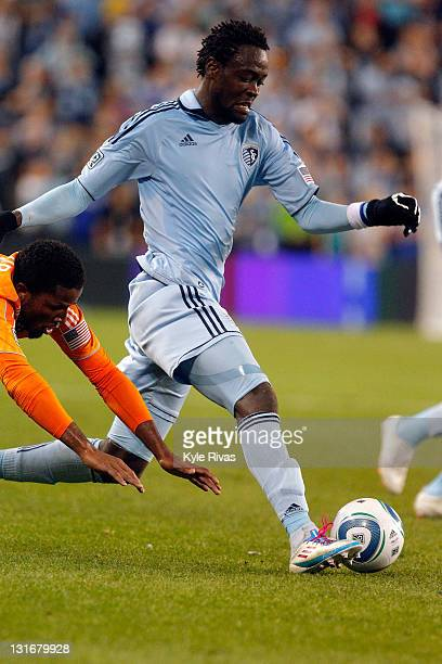Kei Kamara of the Sporting Kansas City drives past Jermaine Taylor the Houston Dynamo in the second half during the MLS Eastern Conference...