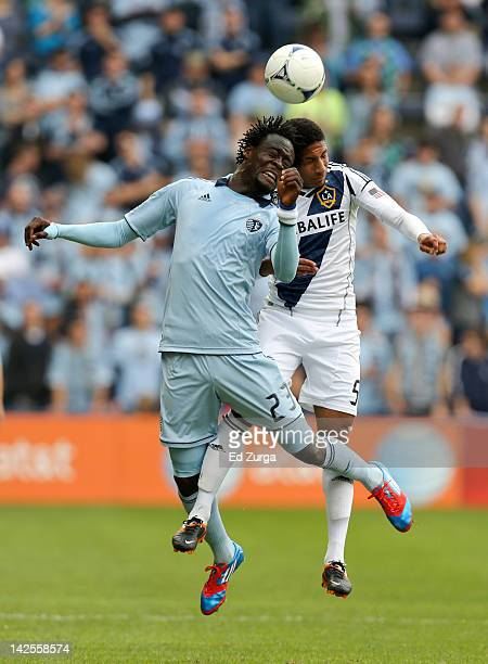 Kei Kamara of the Sporting Kansas City heads the ball away from Sean Franklin of the Los Angeles Galaxy at Livestrong Sporting Park on April 7 2012...