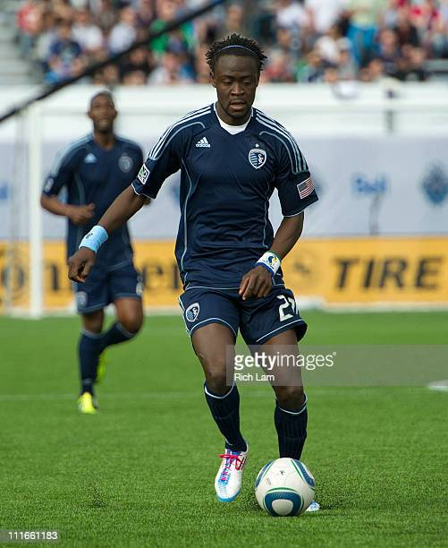 Kei Kamara of the Sporting Kansas City runs with the ball during MLS action against the Vancouver Whitecaps on April 2 2011 at Empire Field in...