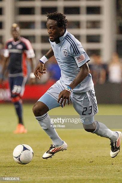 Kei Kamara of the Sporting KC looks for an open man against the New England Revolution early in the second half at Livestrong Sporting Park on July...