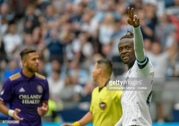 Kei Kamara of the Vancouver Whitecaps celebrates his goal during a match between Orlando City SC and Vancouver Whitecaps FC at BC Place on June 9...