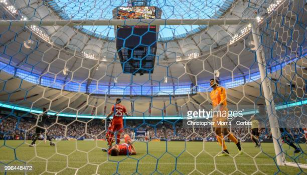 Kei Kamara of the Vancouver Whitecaps FC celebrates his second goal of the match while Jorge Luis Corrales of the Chicago Fire looks on Brandon...