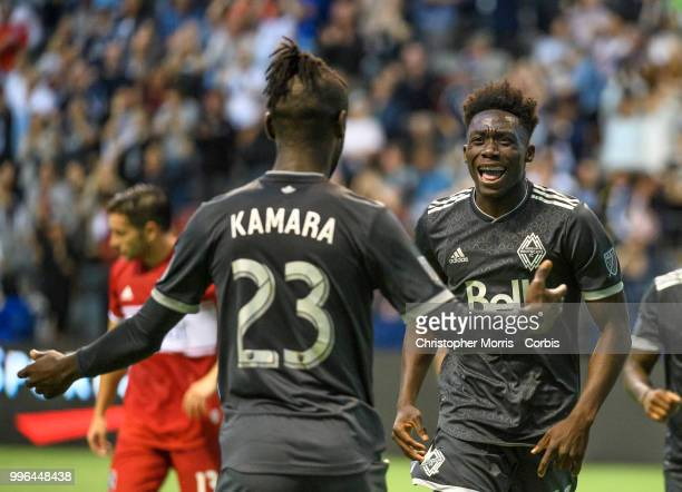 Kei Kamara of the Vancouver Whitecaps FC is congratulated by Alphonso Davies of the Vancouver Whitecaps FC after his goal against the the Chicago...