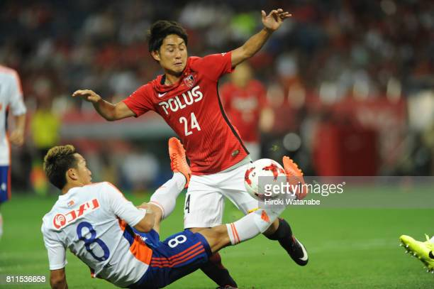 Kei Koizumi of Albirex Niigata and Takahiro Sekine of Urawa Red Diamonds compete for the ball during the JLeague J1 match between Urawa Red Diamonds...