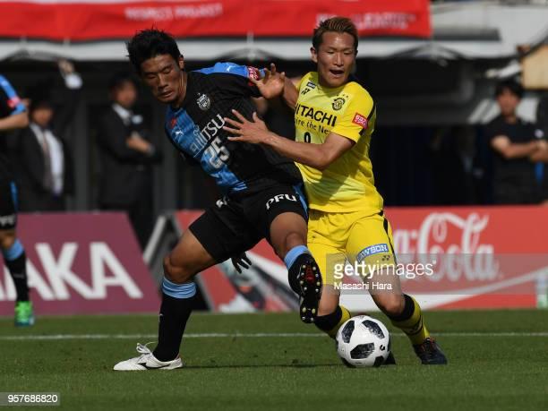 Kei Koizumi of Kashiwa Reysol and Hidemasa Morita of Kawasaki Frontale compete for the ball during the JLeague J1 match between Kashiwa Reysol and...