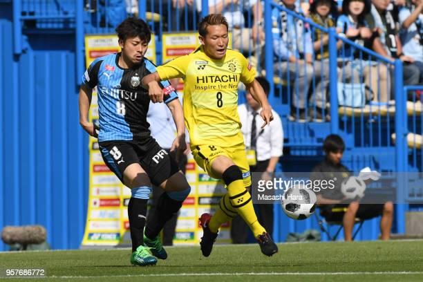 Kei Koizumi of Kashiwa Reysol and Hiroyuki Abe of Kawasaki Frontale compete for the ball during the JLeague J1 match between Kashiwa Reysol and...