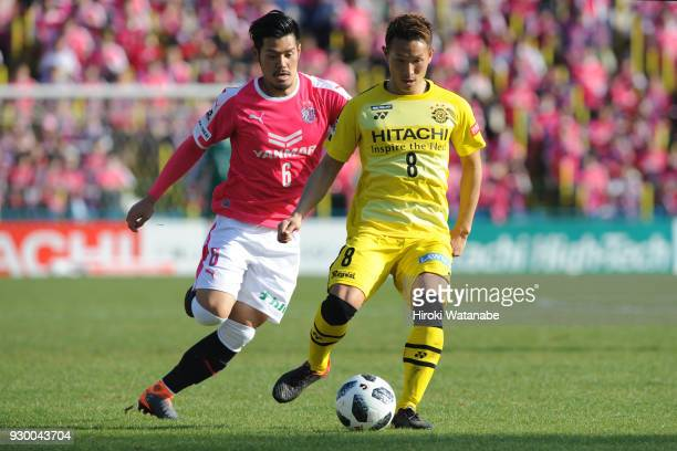 Kei Koizumi of Kashiwa Reysol and Hotaru Yamaguchi of Cerezo Osaka compete for the ball during the JLeague J1 match between Kashiwa Reysol and Cerezo...