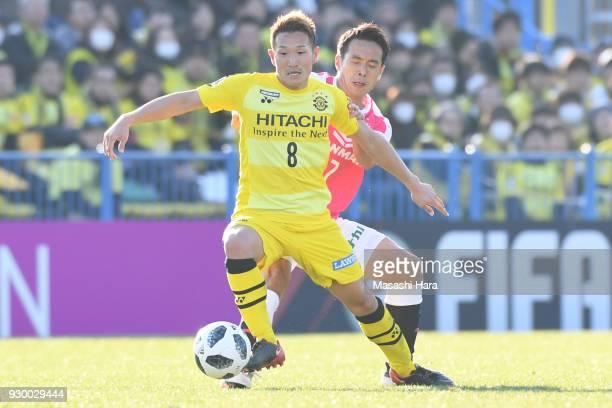 Kei Koizumi of Kashiwa Reysol and Kota Mizunuma of Cerezo Osaka compete for the ball during the JLeague J1 match between Kashiwa Reysol and Cerezo...