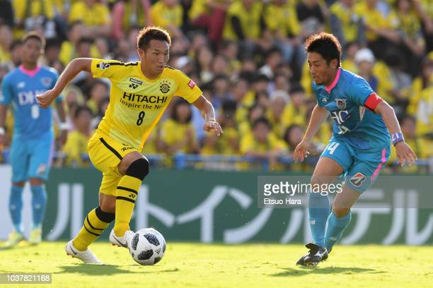 Kei Koizumi of Kashiwa Reysol and Yoshiki Takahashi of Sagan Tosu compete for the ball during the JLeague J1 match between Kashiwa Reysol and Sagan...