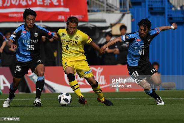 Kei Koizumi of Kashiwa Reysol Hidemasa Morita and Akihiro Ienaga of Kawasaki Frontale compete for the ball during the JLeague J1 match between...