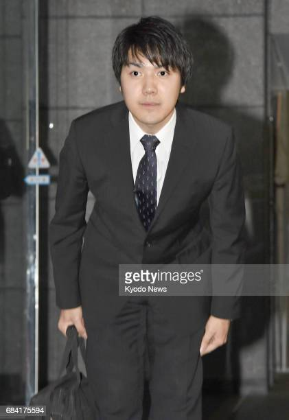 Kei Komuro who will soon become engaged to Princess Mako a granddaughter of Emperor Akihito bows to reporters who gathered to meet him outside the...