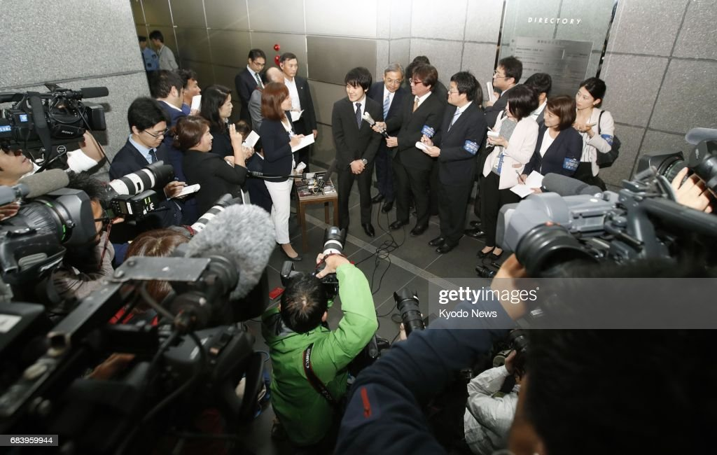 Kei Komuro (C), who will soon become engaged to Princess Mako, the first grandchild of Emperor Akihito, speaks to reporters in Tokyo on May 17, 2017. Komuro, a former fellow student with the princess at International Christian University, works at a Tokyo law firm while attending Hitotsubashi University's graduate school. ==Kyodo
