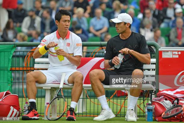 Kei Nishikori and Ben McLachlan of Japan chat prior to their doubles match against Marcel Granollers of Spain and Robin Haase of the Netherlands...