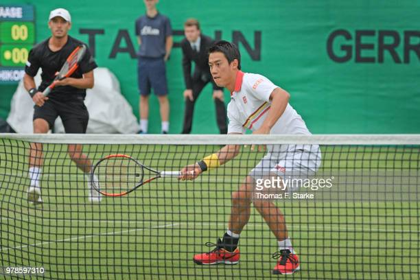 Kei Nishikori and Ben McLachlan of Japan in action during their doubles match against Marcel Granollers of Spain and Robin Haase of the Netherlands...