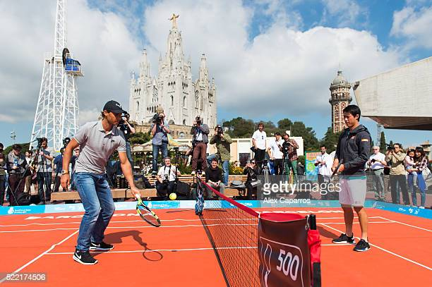 Kei Nishikori and Rafael Nadal attend a promotional event ahead of the Barcelona Open Banc Sabadell at the Tibidabo amusement park on April 18 2016...