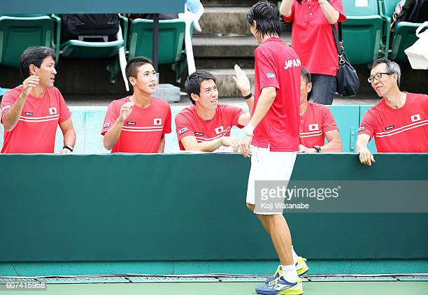 Kei Nishikori and Taro Daniel of Japan celebrate the winner Artem Smirnov of Ukraine during the Davis Cup World Group Playoff singles match between...
