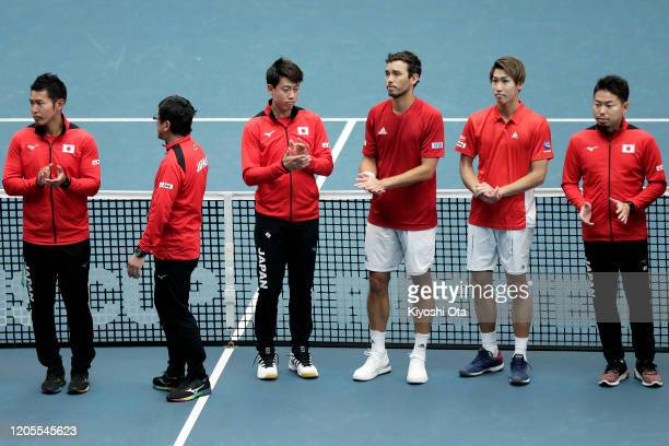 Kei Nishikori Ben McLachlan and Yosuke Watanuki of Japan are seen after the team's 03 defeat against Ecuador on day two of the Davis Cup qualifier...