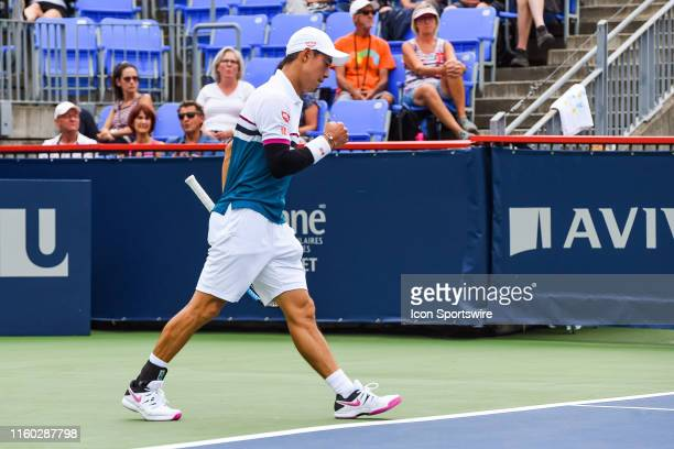 Kei Nishikori celebrates a point while walking back to his bench during the ATP Coupe Rogers second round match on August 7, 2019 at IGA Stadium in...