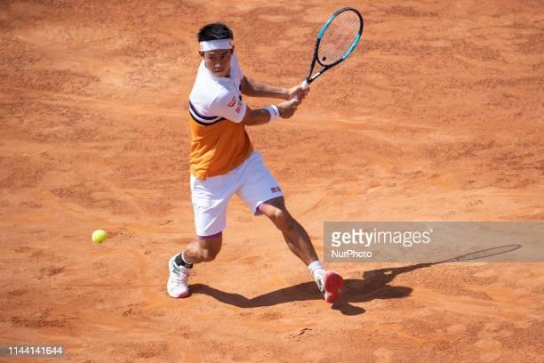 Kei Nishikori in action against Diego Schwartzman during Quarter Final Match at Internazionali BNL D'Italia Italian Open at the Foro Italico Rome...