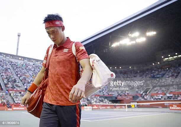 Kei Nishikori leaves the court after retiring from his Japan Open secondround match against Joao Sousa of Portugal with a hip injury at Ariake Tennis...