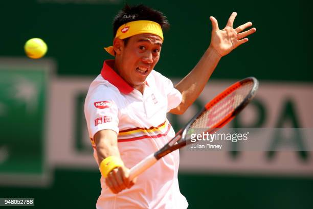 Kei Nishikori od Japan plays a backhand volley during his Mens Singles match against Daniil Medvedev of Russia at MonteCarlo Sporting Club on April...