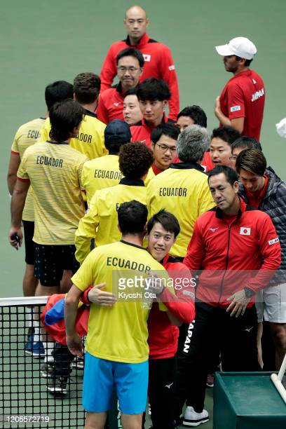 Kei Nishikori of Japan and Emilio Gomez of Ecuador embrace after Ecuador's 30 victory on day two of the Davis Cup qualifier between Japan and Ecuador...