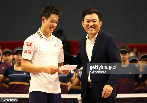 Kei Nishikori of Japan and Rakuten CEO Hiroshi Mikitani poses for photographs with the trophy after the Singles finals round on day seven of the...