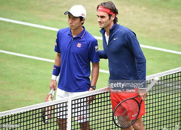 Kei Nishikori of Japan and Roger Federer of Switzerland pose prior to their half final match during day six of the Gerry Weber Open at Gerry Weber...