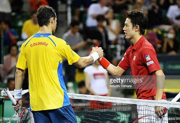 Kei Nishikori of Japan and Santiago Giraldo of Colombia shakes hands after the match during day three of the Davis Cup World Group Play-Off at Ariake...