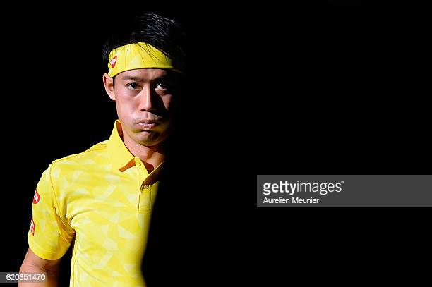 Kei Nishikori of Japan arrives for his Men's second round match against Viktor Troicki of Serbia on day three of the BNP Paribas Masters at Palais...