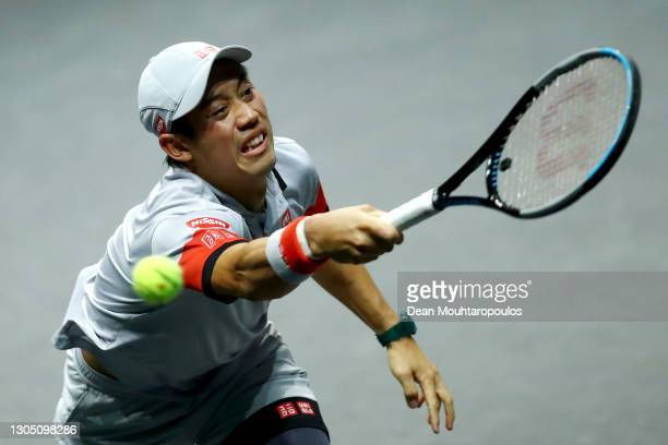 Kei Nishikori of Japan attempts the return a forehand in his match against Alex De Minaur of Australia during Day 3 of the 48th ABN AMRO World Tennis...
