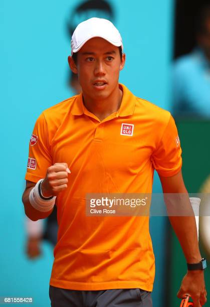 Kei Nishikori of Japan celebrates a point during his match against Diego Schwartzman of Argentina on day five of the Mutua Madrid Open tennis at La...