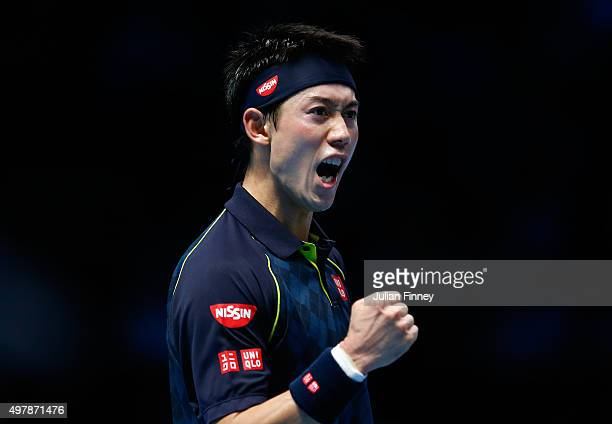 Kei Nishikori of Japan celebrates a point during his men's singles match against Roger Federer of Switzerland during day five of the Barclays ATP...