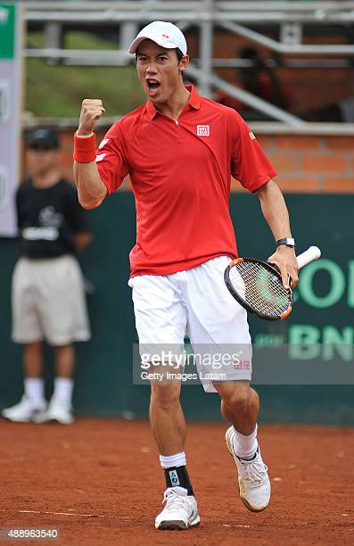 Kei Nishikori of Japan celebrates a point during the Davis Cup World Group Playoff singles match between Alejandro Falla of Colombia and Kei...