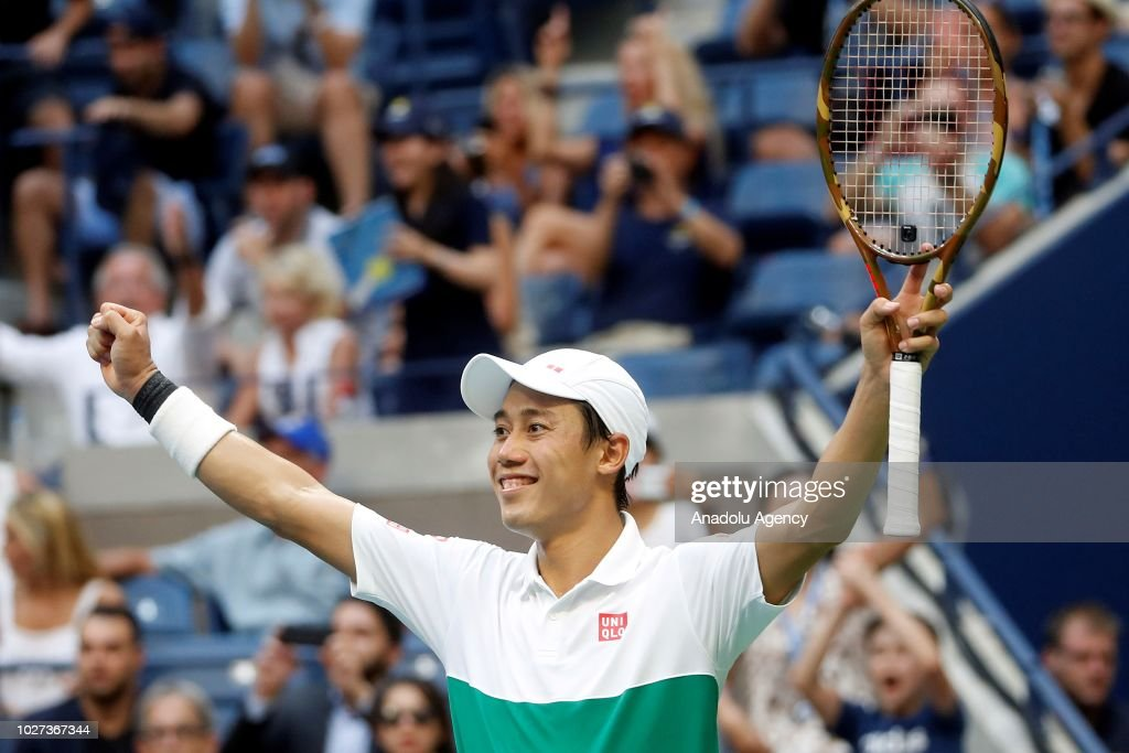 Kei Nishikori of Japan celebrates after defeating Marin Cilic (not seen) of Croatia during US Open men's singles quarterfinals match on September 5, 2018 in New York.