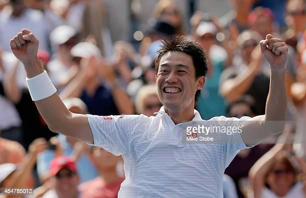 Kei Nishikori of Japan celebrates after defeating Novak Djokovic of Serbia in their men's singles semifinal match on Day Thirteen of the 2014 US Open...