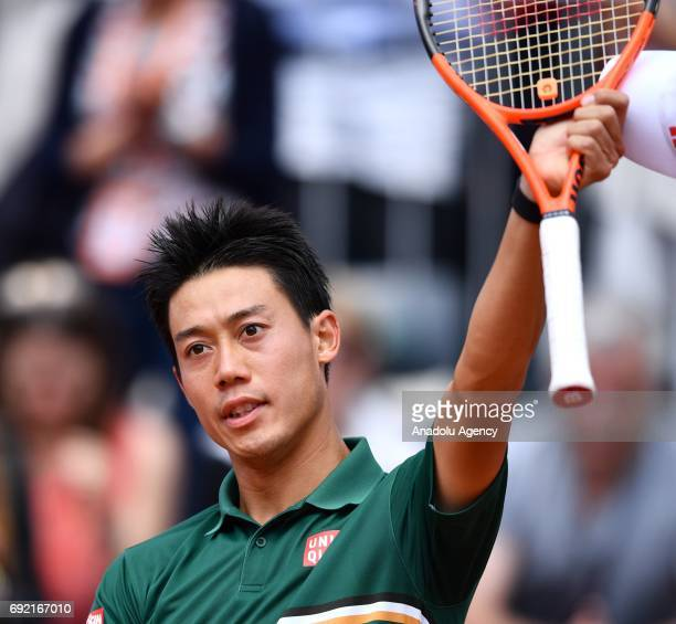 Kei Nishikori of Japan celebrates after he won the match against Hyeon Chung of South Korea during their 3rd round match of the French Open tennis...