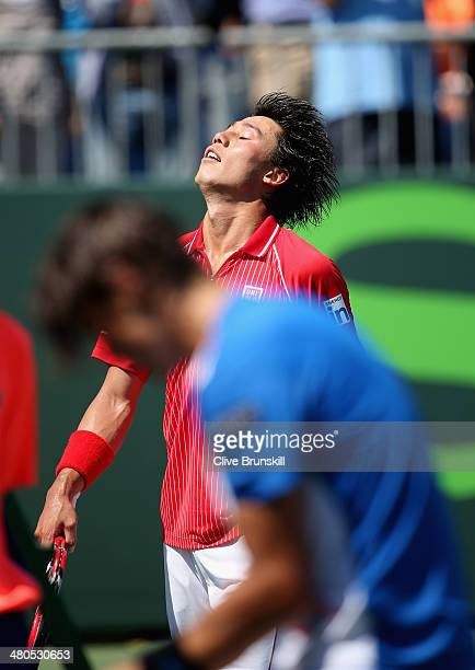 Kei Nishikori of Japan celebrates after his three set victory against David Ferrer of Spain during their fourth round match during day 9 at the Sony...