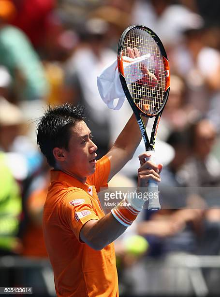 Kei Nishikori of Japan celebrates after winning his first round match against Phillip Kohlschreiber of Gemany during day one of the 2016 Australian...