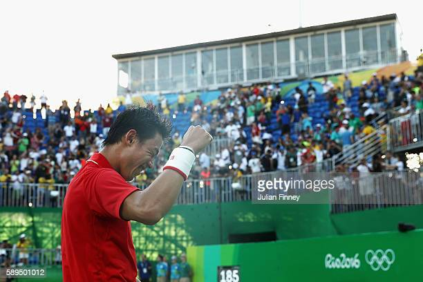 Kei Nishikori of Japan celebrates after winning the singles bronze medal match against Rafael Nadal of Spain on Day 9 of the Rio 2016 Olympic Games...