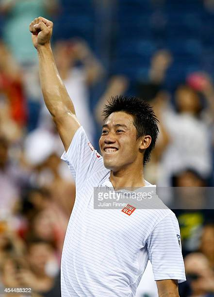 Kei Nishikori of Japan celebrates at match point against Milos Raonic of Canada on Day Eight of the 2014 US Open at the USTA Billie Jean King...