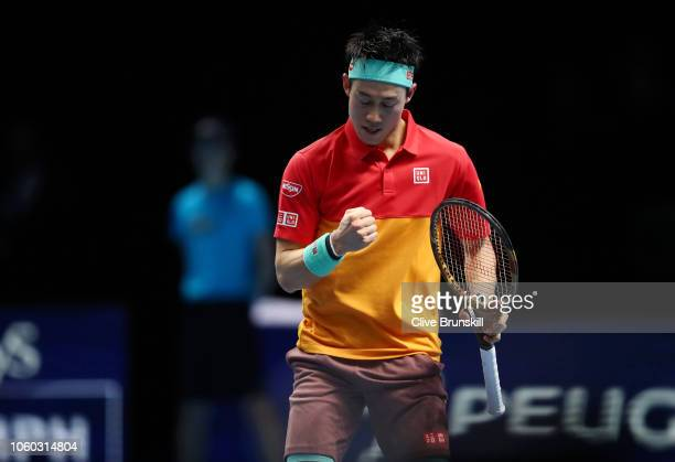 Kei Nishikori of Japan celebrates during his match against Roger Federer of Switzerland during Day One of the Nitto ATP Finals at The O2 Arena on...