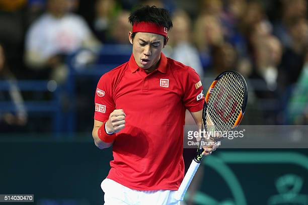Kei Nishikori of Japan celebrates during the singles match against Andy Murray of Great Britain on day three of the Davis Cup World Group first round...