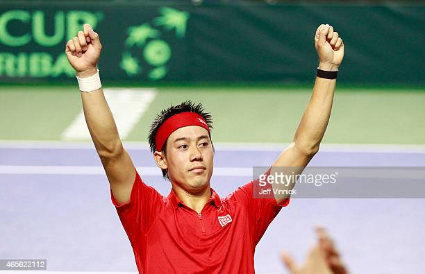 Kei Nishikori of Japan celebrates his Davis Cup match win against Milos Raonic of Canada March 8 2015 in Vancouver British Columbia Canada Nishikori...