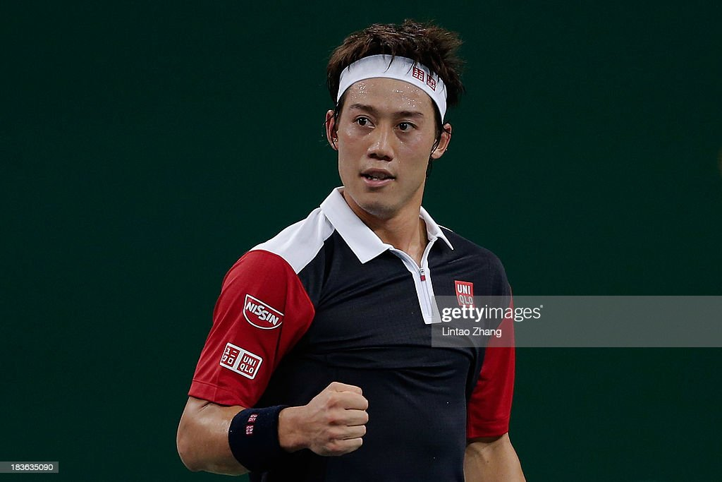 Kei Nishikori of Japan celebrates his win against Grigor Dimitrov of Bulgaria during day two of the Shanghai Rolex Masters at the Qi Zhong Tennis Center on October 8, 2013 in Shanghai, China.