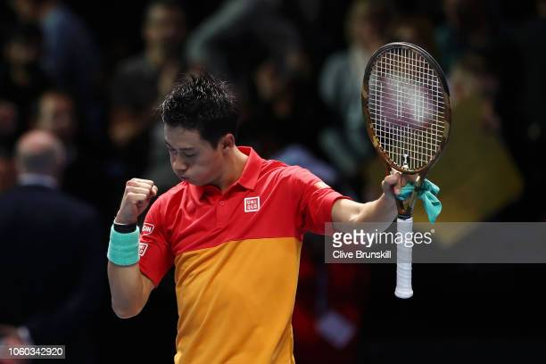 Kei Nishikori of Japan celebrates match point after his match against Roger Federer of Switzerland during Day One of the Nitto ATP Finals at The O2...