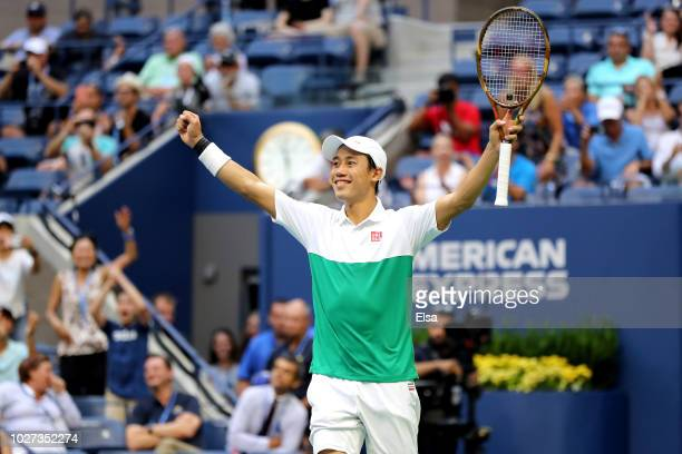 Kei Nishikori of Japan celebrates match point during his men's singles quarterfinal match against Marin Cilic of Croatia on Day Ten of the 2018 US...