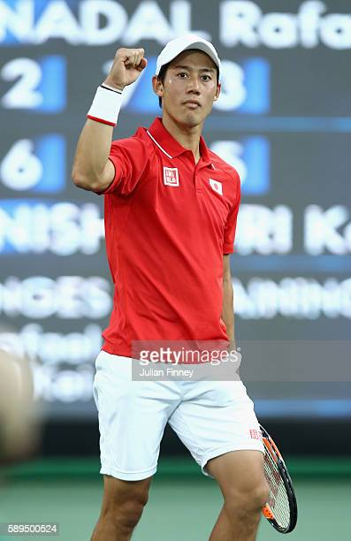 Kei Nishikori of Japan celebrates match point to win the singles bronze medal match against Rafael Nadal of Spain on Day 9 of the Rio 2016 Olympic...